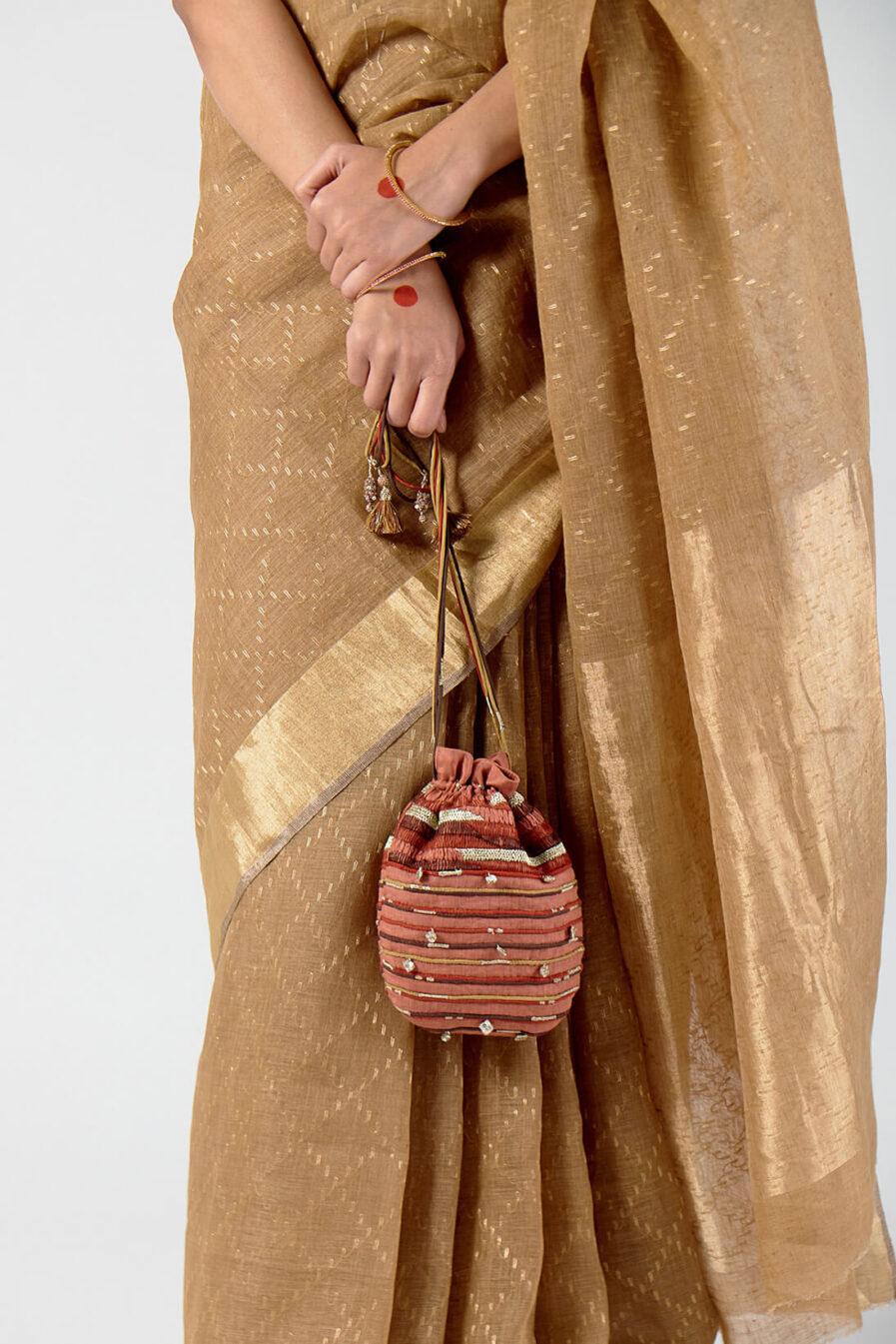 Anavila Corded charms detail potli