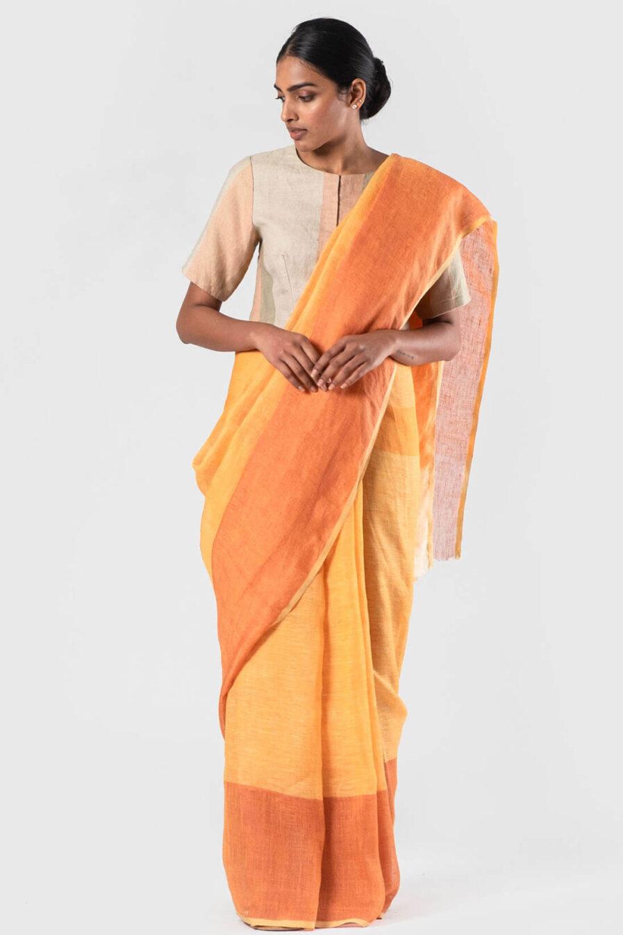 Aanvila Tan and tangerine linen sari