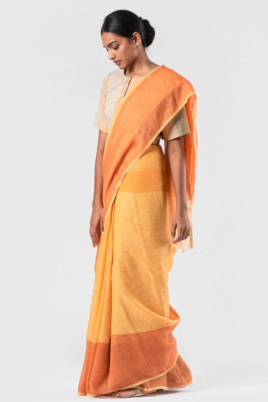 Anavila Tan and tangerine linen sari